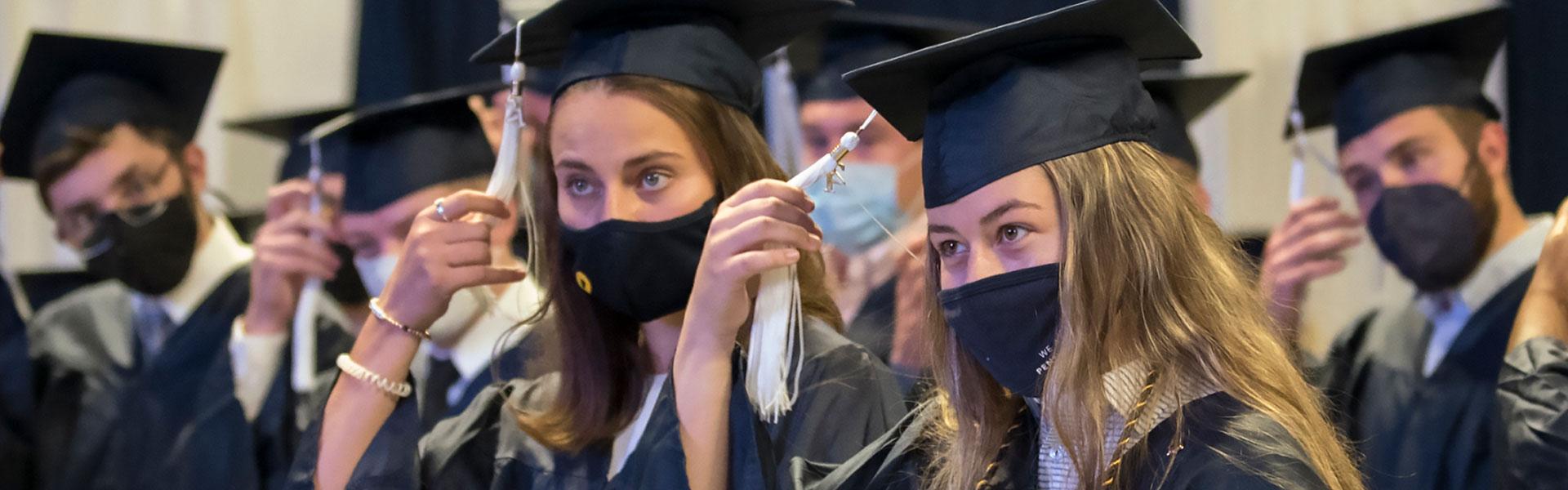 Graduates wearing masks