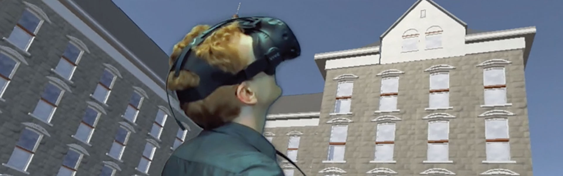 Student using VR to look at Old Main