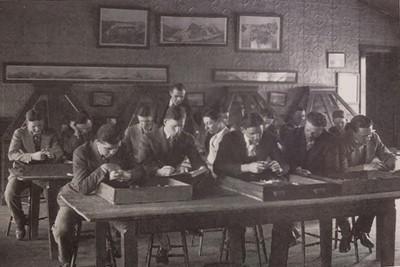 students study minerals in the Old Mining Building, circa 1920