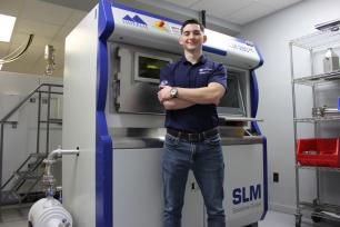 Joseph Sinclair at Imperial Machine & Tool Co. with a SLM 280HL Metal 3D-Printer