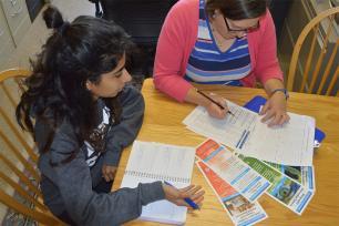 Adviser Jodi Vender helps undergraduate student Harman Singh