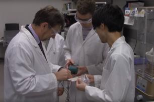 Clive Randall in lab with students