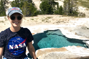 Penn State alum Rachel Kronyak poses next to a hot spring in Yellowstone National Park