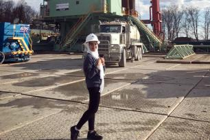 Maram Ejaimi, a senior majoring in petroleum and natural gas engineering, tours an oil well