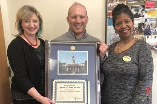 Leslie Laing, director for Penn State Adult Learner Programs and Services presents diploma case to OASA Recipient Timothy Bowen