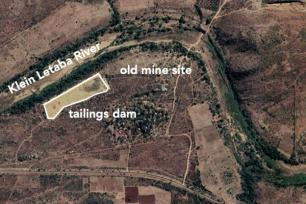 Satellite image of gold mine tailings dam (outlined in white) next to the Klein Letaba River in the Limpopo Province