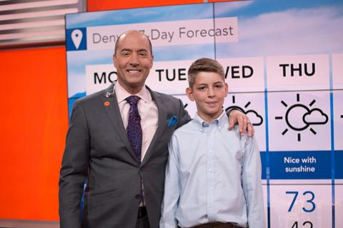 Cullen Slattery stands with one of his meteorology heroes, Bernie Rayno, a Penn State alumnus and chief video meteorologist