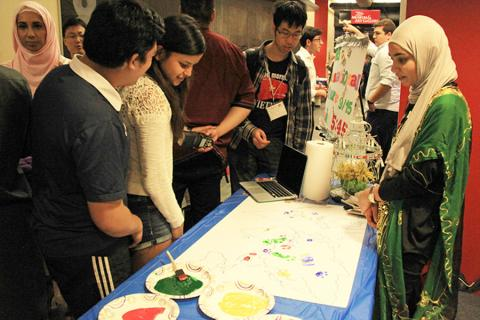 Students participated in a world map coloring activity during the first International Culture Night in 2015.
