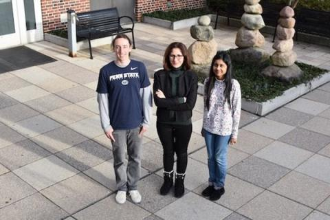 Ezgi Toraman outside the Steidle Building with her graduate students Sean Okonsky, left, and Antara Bhowmick, right.