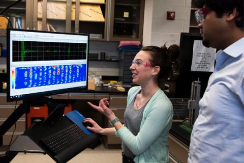 Researchers demonstrate the technology used to analyze wave propagation data.