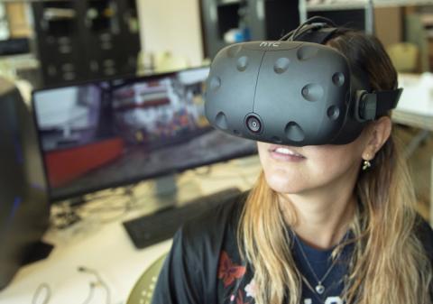 "Doctoral student Debora Verniz uses a virtual-reality headset to """"visit"" the favela Santa Marta in Rio de Janeiro, Brazil."