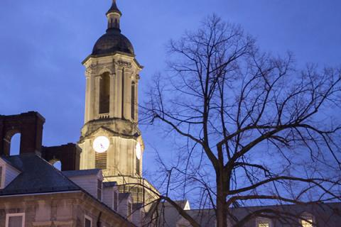 Old Main at dusk on Penn State's University Park campus.