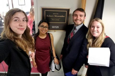 Tom Nigl, third from left, and fellow members of Penn State's Science Policy Society, speak with members of U.S. Congress
