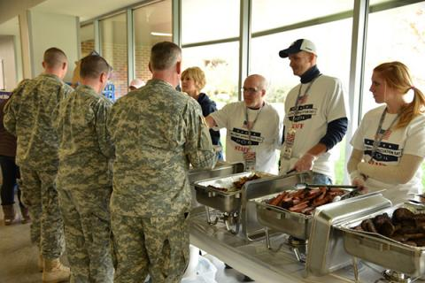 Attendees in line at the 2014 Military Appreciation Tailgate at the Pegula Ice Arena.