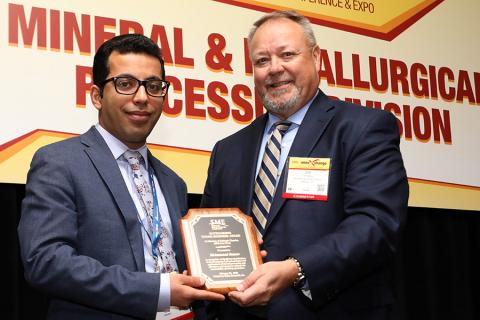 Mohammad Rezaee, left, received the Outstanding Young Engineer Award from the Society for Mining, Metallurgy & Exploration
