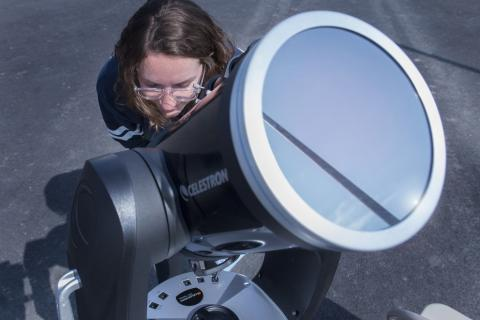 Chloe Stanton, a NASA PA Space Grant Fellow, has a look at the sun through a highly-filtered telescope