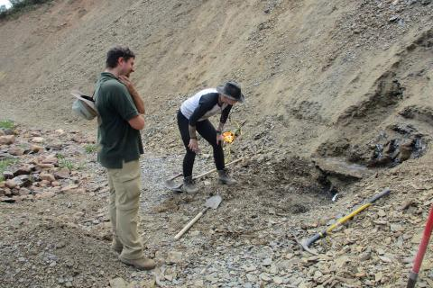 Julien Kimmig and Rhiannon LaVine investigate exposed Spence Shale sediments in Spence Gulch, Indiana
