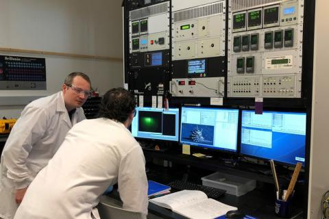 Roman Engel-Herbert, assistant professor of materials science and engineering, characterizes thin films with a grad student