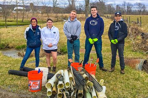 Positive Energy members help clean up a riparian buffer zone with ClearWater Conservancy.