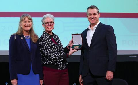 Cynthia Brewer accepts the O.M. Miller Cartographic Medal from the American Geographical Society