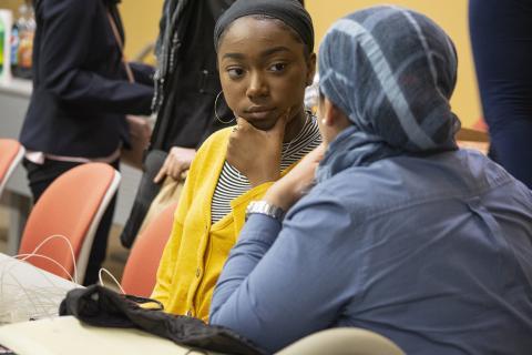 Faculty mentor Ola Rashwan, speaks with high school student Zimirah Wilson (left), at an EnvironMentors meeting
