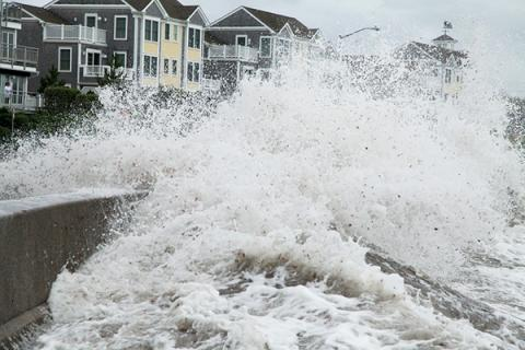 Storm surge batters a coastal area.