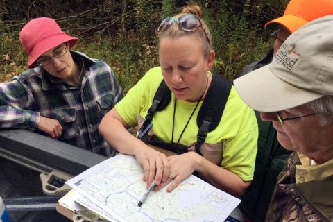 Volunteers collecting water quality samples in the Allegheny National Forest for Snapshot day pause to find another test site.