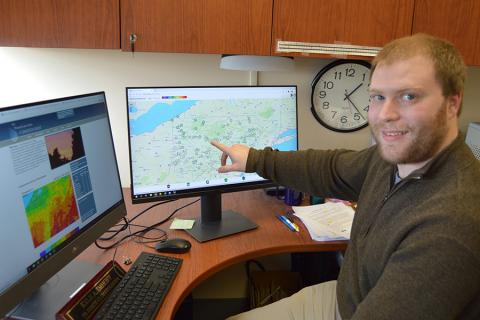 Kyle Imhoff, the Pennsylvania state climatologist, explaining weather data.