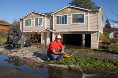 Sultan, Washington, Nov. 11, 2006 — Mitch McKron pumps water from the basement