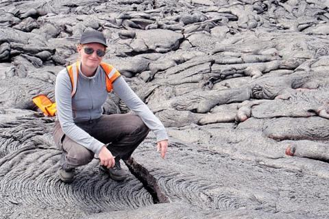 Christelle Wauthier, associate professor of geosciences, in Hawaii at an active lava flow on Kilauea volcano