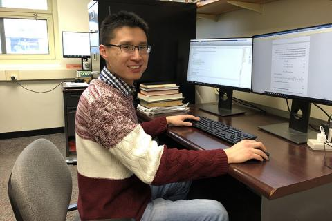 Wei Zhang coding for his research