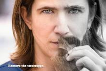"""Paleontologist Ellen Currano removes a faux beard from her face for """"The Bearded Lady Project: Challenging the Face of Science."""""""