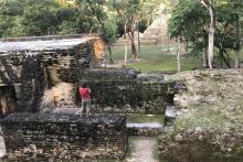 Jiawei Huang, a doctoral student in geography, conducts field work at the Cahal Pech Maya ruins in Belize, Central America.