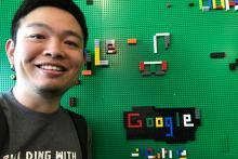 Geography doctoral student Xi Liu stands next to a Lego display in Google's Seattle offices.