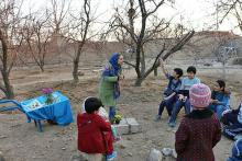 """Geography graduate student Elham Nasr Azadani tells a story to students at the nature school about """"Yalda Night."""""""