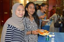Students sampling food at the College of Earth and Mineral Sciences International Culture Night.
