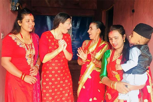 Marie Louise Ryan, second from left, celebrates Dashain in Lamjung, Nepal