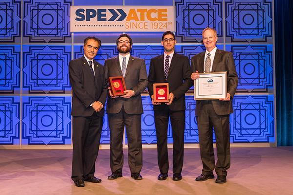 Sami Alnuaim presents Michael Cronin, Hamid Emami-Meybodi and Russ Johns with awards