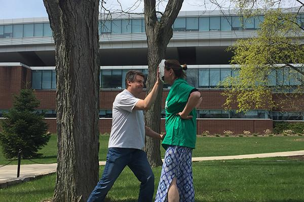 Marisa Ferger, a lecturer in meteorology, is hit in the face with a pie as part of a student fundraiser.
