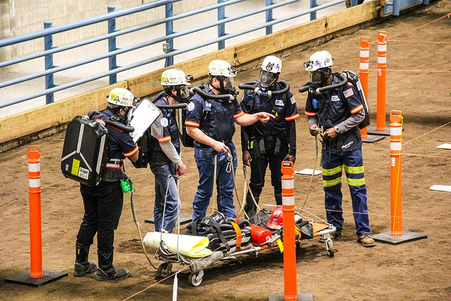 The Penn State Mount Nittany Mine Rescue Team works it way through the mock mine hazards at a mine rescue contest