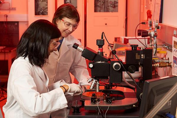 Right, Suzanne Mohney, professor of materials science and engineering, works with one of her students