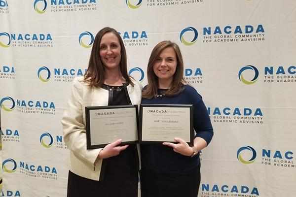 Hilleary Himes, left, recently accepted awards from NACADA: The Global Community for Academic Advising
