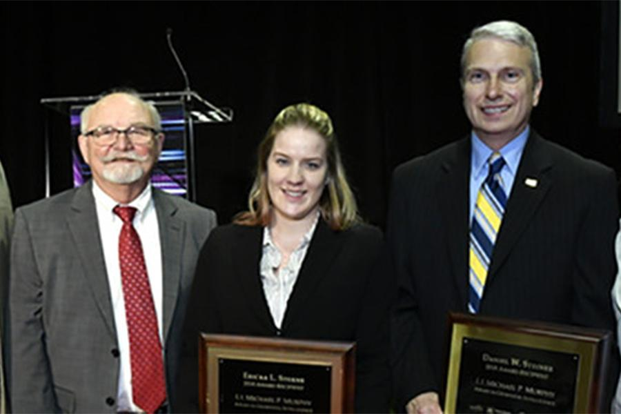 Ericka Sterns and Daniel Steiner recently accepted the 2018 Michael P. Murphy Award in Geospatial Intelligence
