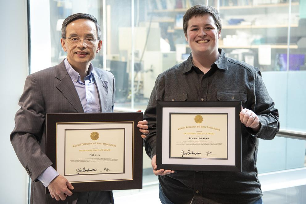 Zi-Kui Liu and Brandon Bocklund pose with their NASA Software of the Year awards