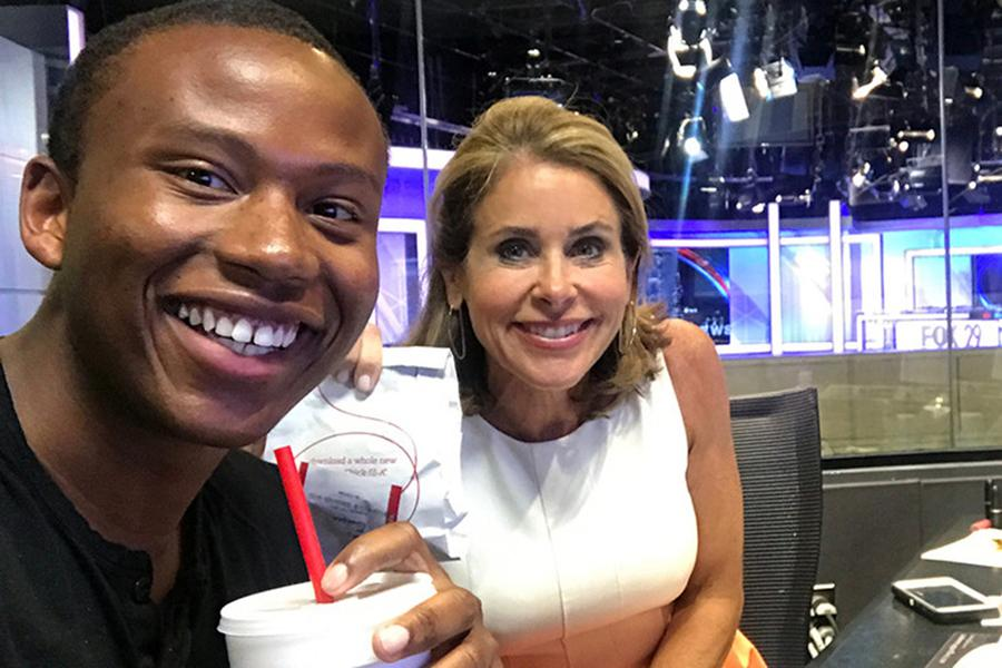 Meteorology intern Robert Johnson and his mentor Kathy Orr having lunch in the FOX 29 studio.