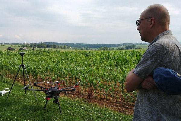 Douglas Miller examines drones used in his research