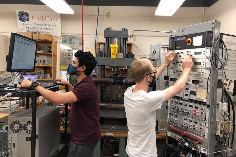 Clay Wood (right), doctoral candidate in geosciences, helps run a series of tests on fractured rock using acoustic vibrations