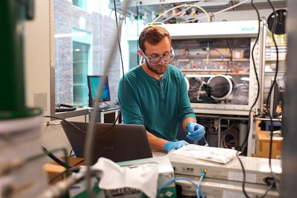 Ryan Fair, doctoral candidate in materials science and engineering, conducts research into cold sintering.
