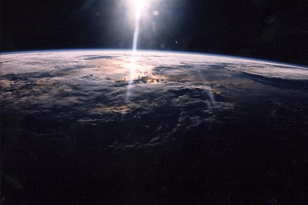 Sunlight over Earth as seen by STS-29 crew onboard Discovery, Orbiter Vehicle (OV) 103.