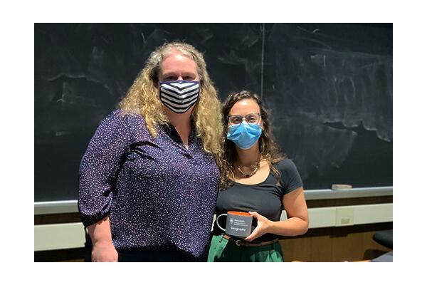 Louisa Holmes, assistant professor of geography, left, with speaker Heather Randell
